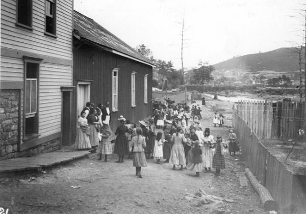 A group gathers outside of a building on a colliery payday, Girardville, PA, 1894.
