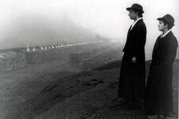Black and white photograph of two Missionary Trinitarian Sisters of the Most Blessed Trinity and row of working Coke Ovens.