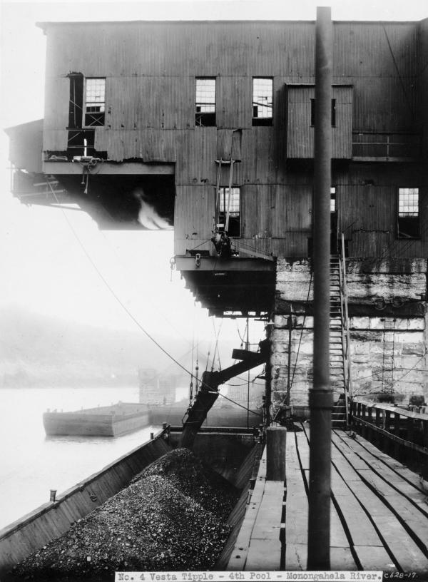 Coal being loaded into barges from a tipple.