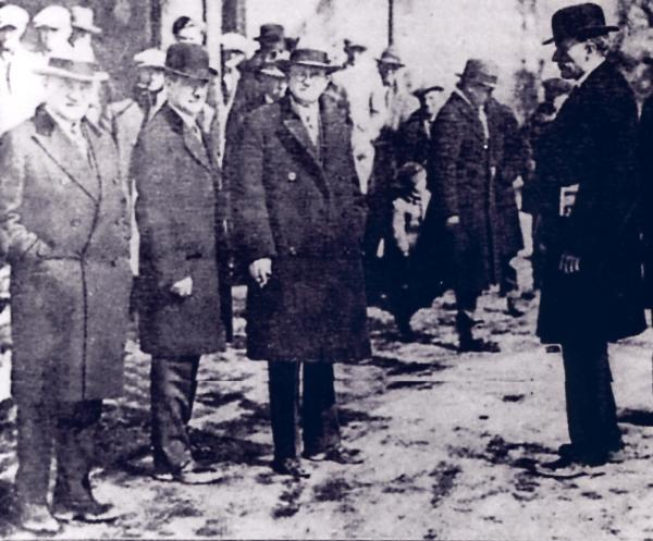 Photograph of the Senators posing for photograph as onlookers stand in the background. Senators are from Left to right: Senator Wagner, New York; Senator Pine, Oklahoma; Senator Gooding, Idaho; chairman Senator Wheeler, Montana, with newspaper in his pocket.