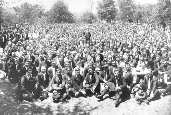 This publicity photo of several thousand Windber miners, and some of their children, was taken in an open field soon after their decision to continue the strike for union.