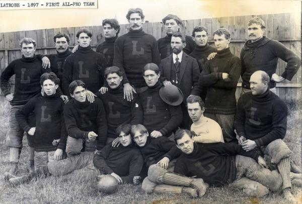Team Photo of 1st team of all paid football players in uniform.