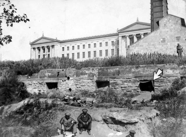 In Philadelphia, a group of homeless men dugs shelters into walls near the Philadelphia Art Museum. The arrow in this photo points to a cave, scooped out and braced, that sheltered three men, who attempted to keep themselves warm with an open fire.