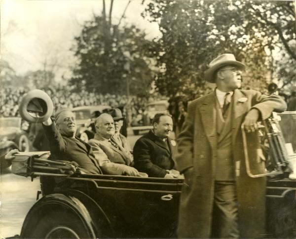President Roosevelt riding from the Pennsylvania RR Station to the Capital building with Senator Joseph F. Guffey and Governor George Earle.