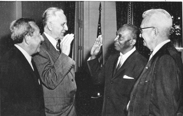 Robert N. C. Nix taking his oath as Congressman, sworn in by House Speaker Pro Tem John W. McCormack (D-Mass) second from left. Also participating in the ceremony were Philadelphia Congressman William J. Green Jr., (left) and Congressman Francis E. Walter of Easton, PA (right), who was head of the Pennsylvania Democratic Delegation.  January, 1959
