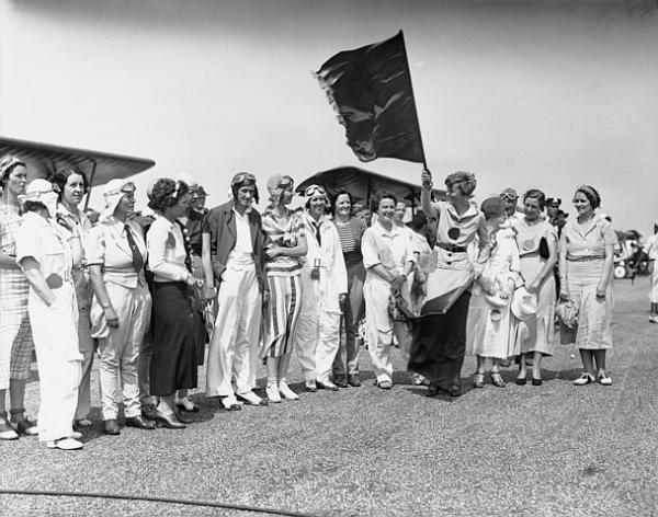 "Pictured above are the principals in the Annette Gipson Trophy Race for women which was held at Roosevelt Field, Long Island, June 24th. Left to right: Miss Laurel Sharpless, New York City; Miss Edna Gardner, winner; Miss Edith Descomb, Hartford, Connecticut; Arline Davis, Cleveland, Ohio; Frances Marsalis, Garden City, N.Y.; Margery B. Ludwigsen, Brooklyn, N.Y.; Suzanne Humphrey, Far Hills, N.Y.; J.T. ""Peggy"" Remmy, New York City; Annette Gipson, sponsor; Helen Richey, McKeesport, Pennsylvania; Amelia Earhart, starter; Mrs. I.J. Fox, backer; Amy Mollison, British flyer, and Ruth Nichols."