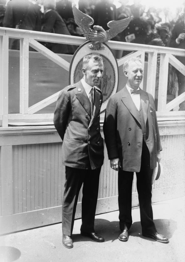 Al Smith and Smedley Butler dressed in suits pose for this photograph.