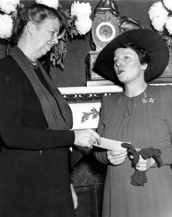 Pearl Buck receiving a check from First Lady Eleanor Roosevelt for the China Relief Legion, December 16, 1940.