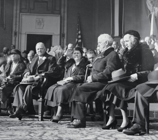 Seated in a row are Left to right, just before the President spoke are: Mrs. Hoover; President Hoover; Mrs. A. Hampton Moore, wife of the Mayor of Philadelphia, and William H. Vare, former Pennsylvania Senator and Republican leader of Pennsylvania.