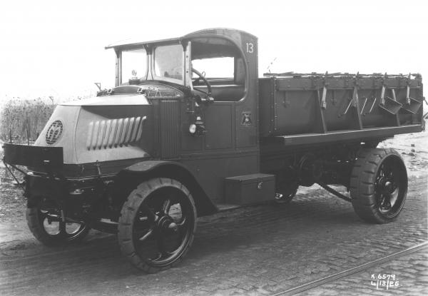 Black and white image of a dump truck.
