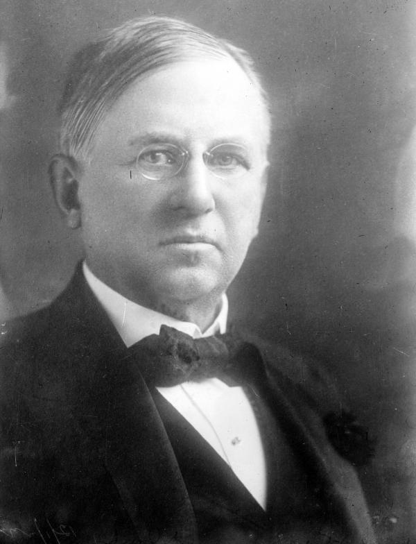 Black and white portrait of a man in a suit.