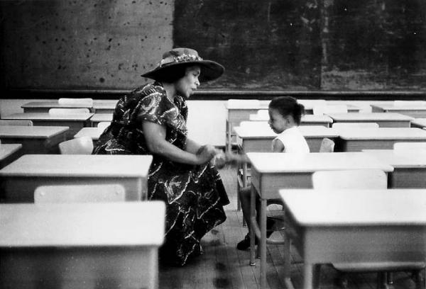 Marian Anderson talking to a youngster in a Philadelphia public school