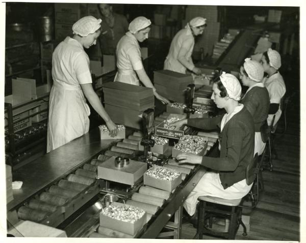 Production; wrapping department, Kiss; female employees; assembly line, women verifying weight of 2 pound boxes, 1936-1937