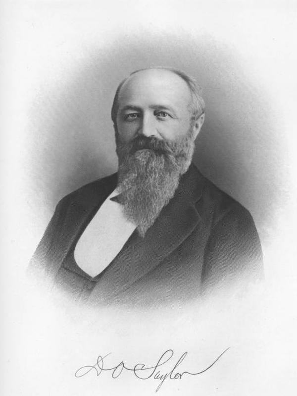 Portrait of David O. Saylor, head and shoulders, wearing a suit.