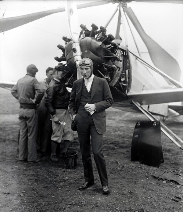 Harold F. Pitcairn, President of Pitcairn Aviation Company, standing in front of strange, Windmill autogiro plane that he piloted on first long trip from Philadelphia to Washington
