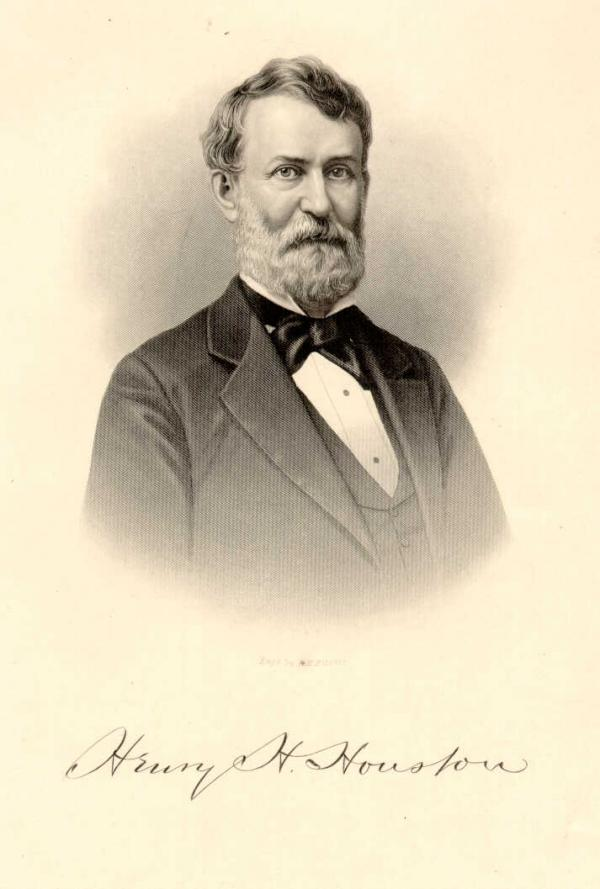 Head and shoulders portrait of a man in a suit and bowtie.