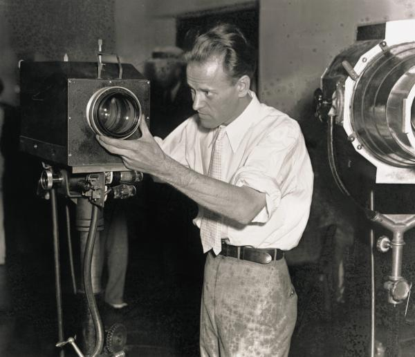 Inventor Philo T. Farnsworth adjusts a television camera during a demonstration of his television system at the Franklin Institute in Philadelphia, 1934.
