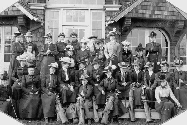 "Women golfers pose before the ladies"" clubhouse at St. Martin's, early twentieth century."