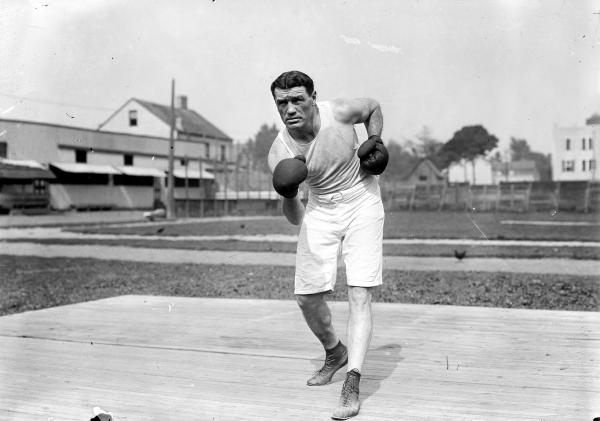 Jack O'Brien in a boxing stance, posing for photo.