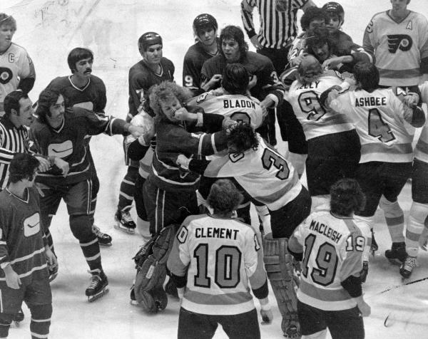 Some Philadelphia Flyers brawling with the Vancouver Canucks on ice.