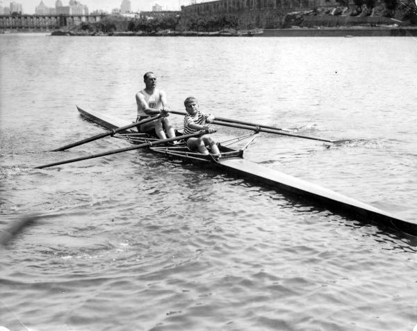 John B. Kelly with his son John Jr. sculling on the Schuylkill River.