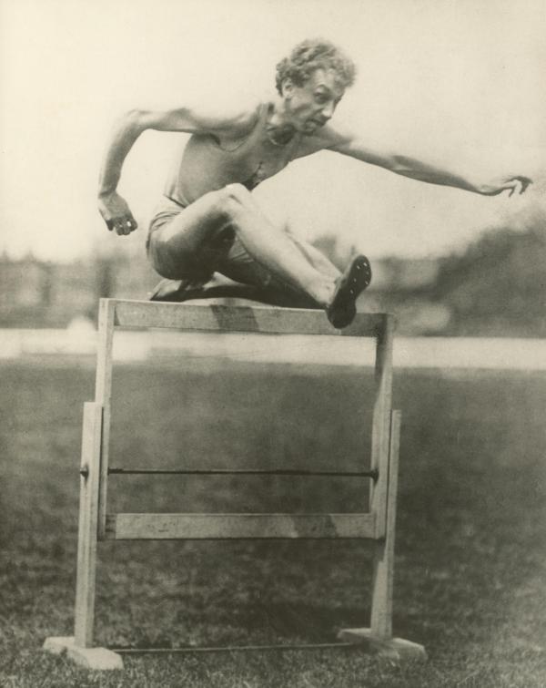 University of Pennsylvania track star Alvin Christian Kraenzlein hurdling.
