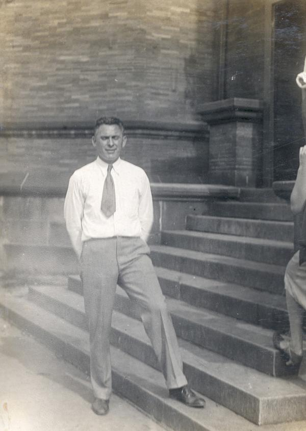 Homestead swim coach Jack Scarry standing on the steps of the Homestead Library.