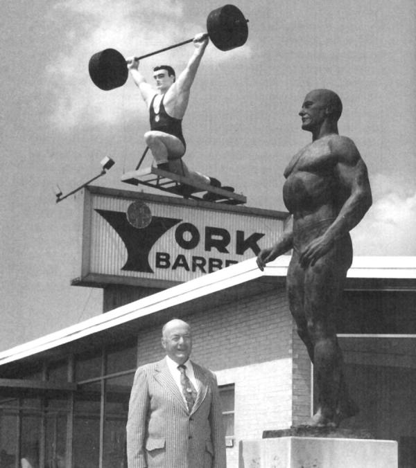 Bob Hoffman outside the York Barbell plant beneath a statue of himself and the revolving weightlifter sign that was visible from Interstate 83.