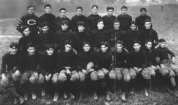 Carlisle Indian School Football Team of 1908 including Jim Thorpe, Coach Warner and 24 other team members, all in uniform.