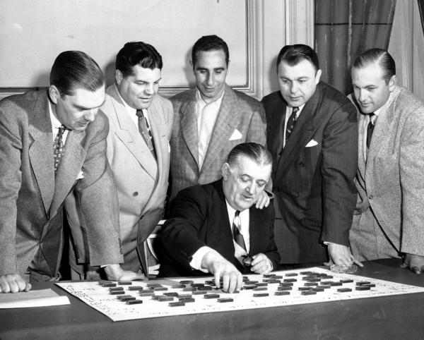 Commissioner Burt Bell working on the NFL schedule for the upcoming season. March 27, 1951.