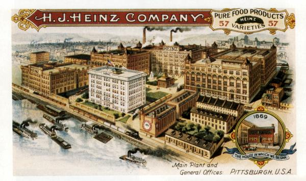 Color image of the Heinz complex bordering the railroad tracks and the river, which is full of steam ships.