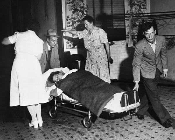 A victim of deadly smog is rushed to the hospital.
