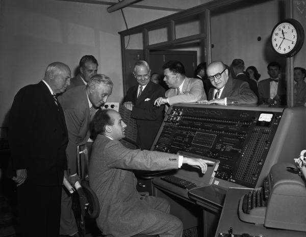 J. Presper Eckert is shown demonstrating the UNIVAC mainframe computer that he helped design.