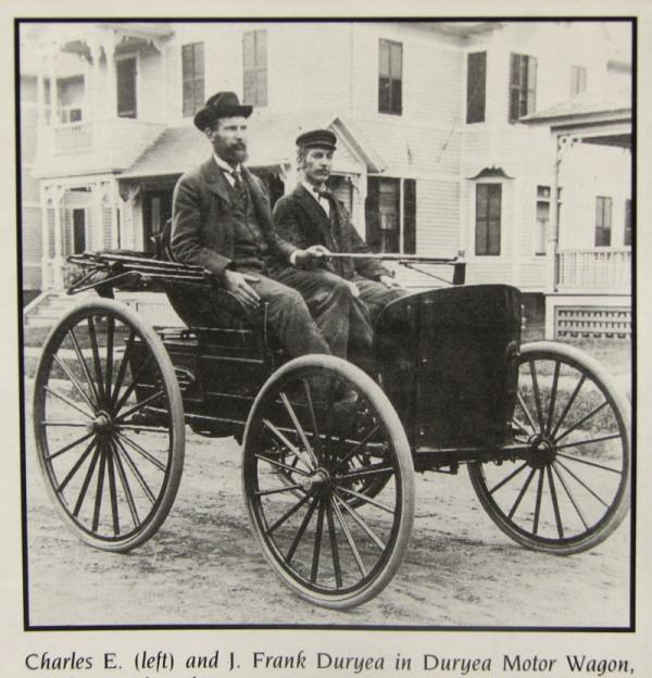 The Duryea brothers, J. Frank and Charles E. sitting in their car.