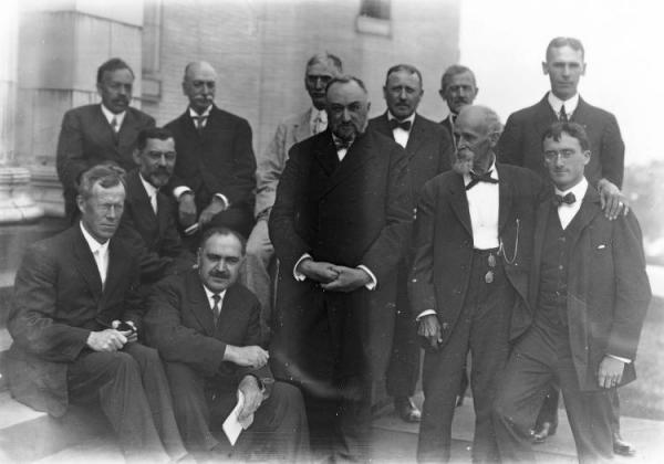On the Steps of the Allegheny Observatory: John Stanley Plaskett (Back left), William Snyder Eichelberger, Frank C. Jordan, Frank Schlesinger, Edward C. Pickering (Standing in the Center), John A. Brashear (to the Right of Pickering), William Thaw (Seated Left of Pickering) and Daniels.