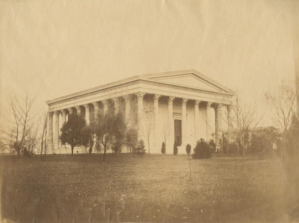 View looking southwest showing the hall constructed 1833-1847 in the Greek Revival Style after the designs of Philadelphia architect Thomas Ustick Walter. Also shows a partial view of a neighboring building left of the hall and several trees in the foreground.