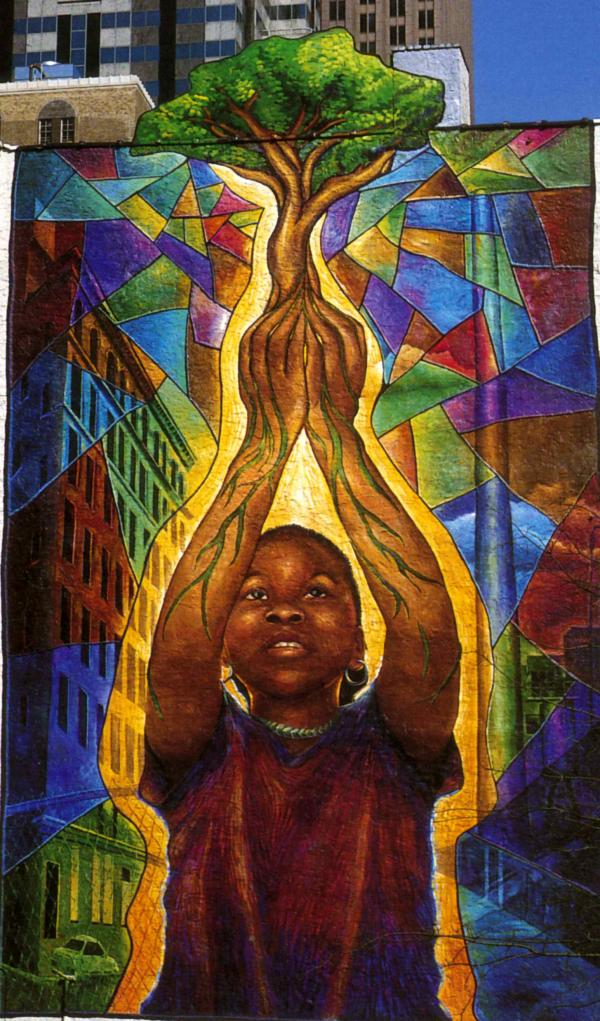 The mural features an African American girl reaching for the sky, a towering tree sprouting from her up-stretched hands. The girl has roots instead of veins running through her arms. In the bottom left corner looms a small collection of more ominous images, including an abandoned car and boarded-up buildings. Symbolically the painting is a testament to the value of human aspiration, a visual homage to the notion of dreaming it and achieving it.""