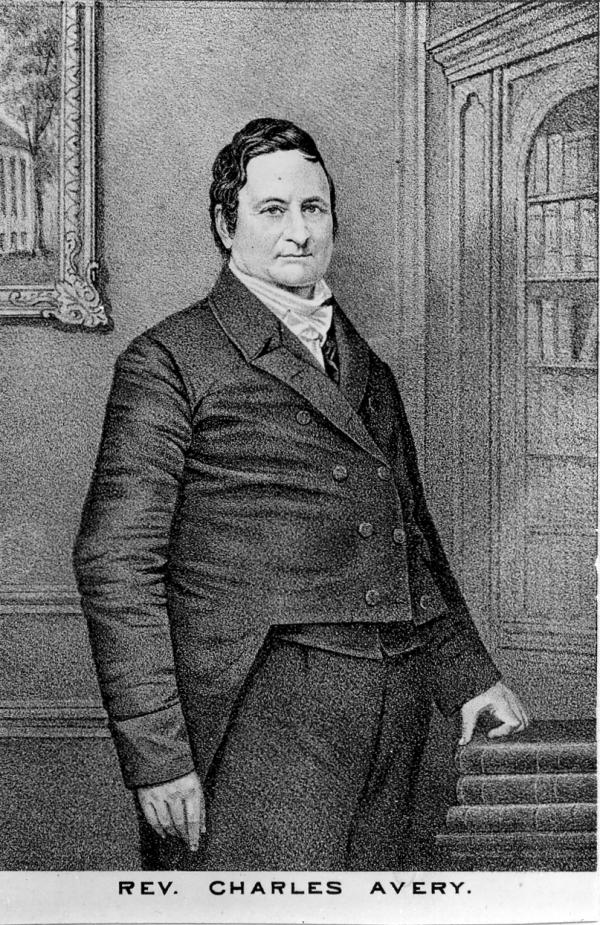 Black and white portrait of Charles Avery standing.