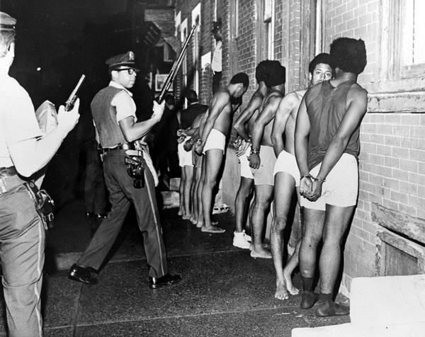 Members of the Black Panther Party, stripped, handcuffed, and arrested after Philadelphia police raided the Panther headquarters, August, 1970.