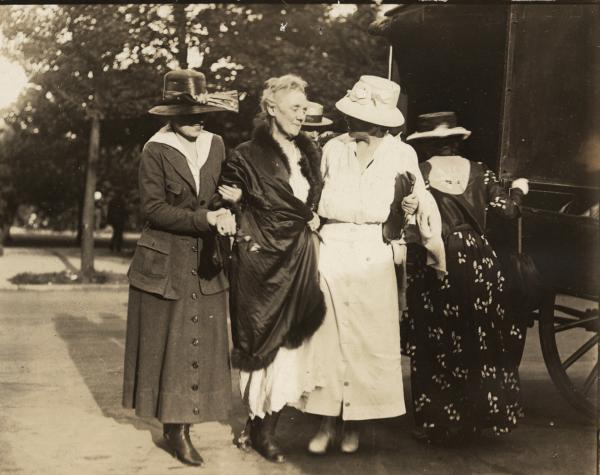 """Mrs. Lawrence Lewis Arriving at Headquarters after Five Days in Prison. She Is Being Supported by Miss Clara Louise Rowe and Mrs. Abby Scott Baker."" Accompanying story"