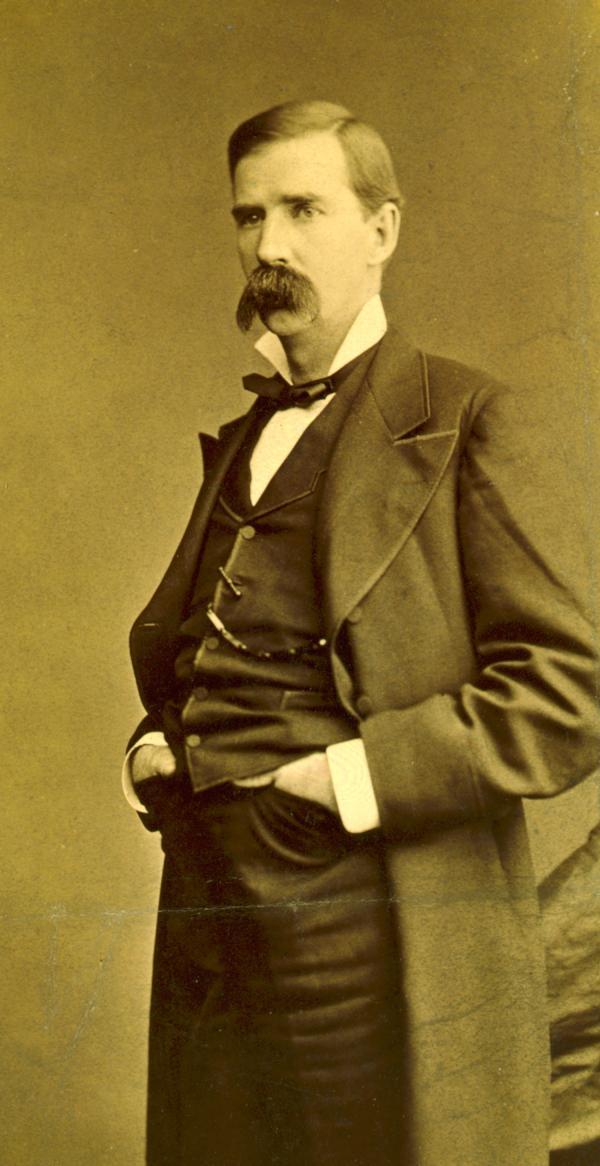 James Donald Cameron, senator from Pennsylvania, three-quarter length portrait, standing, facing left.