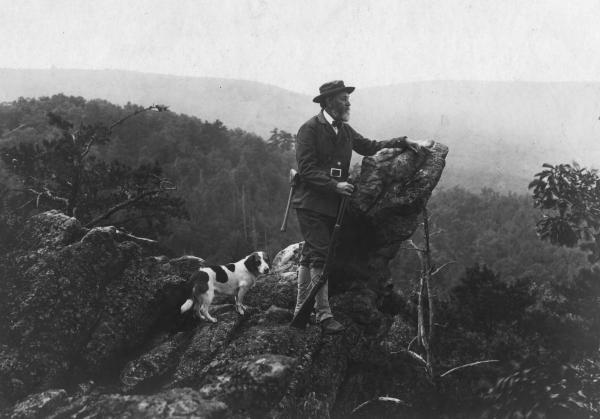 Joseph Rothrock and his dog look out over the edge of Eagles Rock.