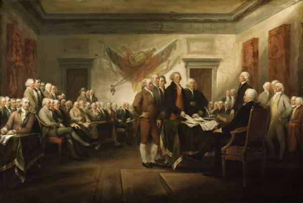The first painting that Trumbull completed for the Rotunda shows the signing of the Declaration of Independence in what is now called Independence Hall, Philadelphia. The painting features the committee that drafted the Declaration of Independence – John Adams, Robert Sherman, Thomas Jefferson (presenting the document), and Benjamin Franklin – standing before John Hancock, the President of the Continental Congress. The painting includes portraits of 42 of the 56 signers and 5 other patriots.