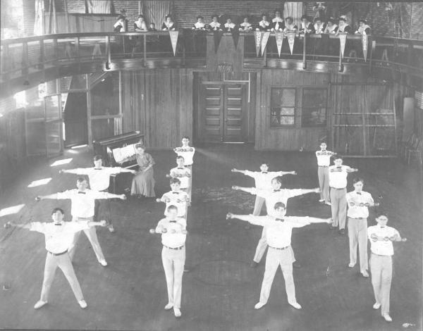 Men exercising in gym.