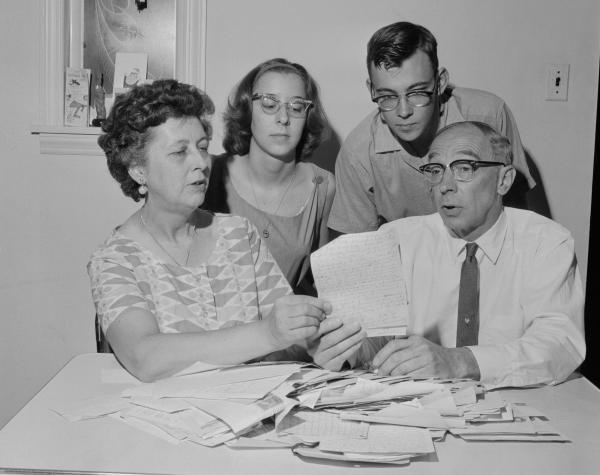 Mr. and Mrs. Edward L. Schempp go through some of the more than 500 letters received by them in the past five years with the help of their children, Donna, 17, and Roger, 20.