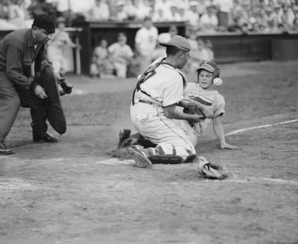 Little League player steals home in Little League World Series semi-final game, 1954.