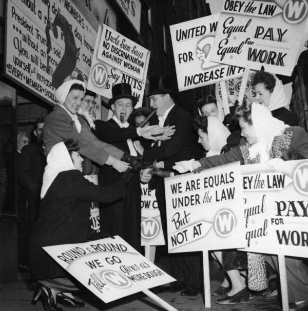 Equal Rights Movement Demonstration During the 1946 Strike. Two Men are Dressed in Tuxedos and Smoking Cigars, and Women are Holding Picket Signs.