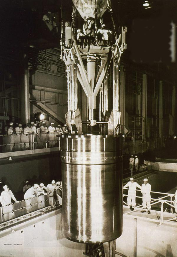 Fifty-eight-ton reactor core being lowered into the pressure vessel