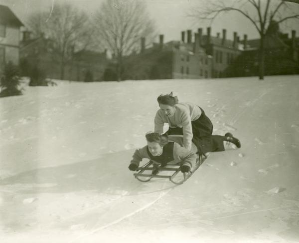 Students at Westtown School, on a snow covered hill, riding a Flexible Flyer