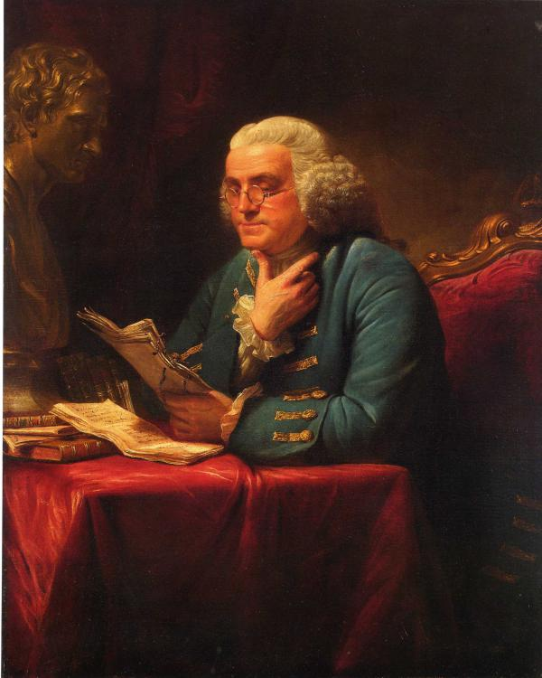 Benjamin Franklin, half-length portrait, seated at table, facing left, reading documents